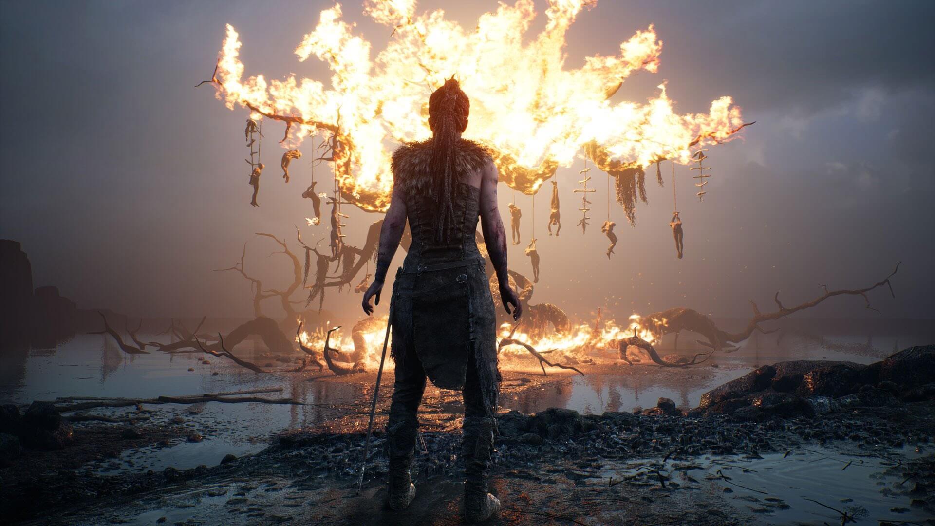 Hellblade - árbol quemándose con muertos colgando